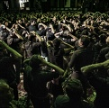 Men are gathered in the Hosseiniyeh, a kind of mosque, mourning the martyrdom of Imam Hossein. Nooshabad, november 2014.