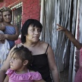 Silvia, in the center of the image surrounded by grandchildren and a daughter, is the mother of two girls who survived the trafficking. Now both are admitted to a psychiatric hospital for post traumatic stress. Buenos, Argentina. February 2017.