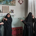 Women preparing for commemoration rites for the martirtom of Imam Hossein. Nooshabad, Iran. November 2012.