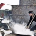 A man prepares a typical dish of Ashura, the Halim. Women do not cook during Ashura days. Nooshabad, Iran, November 2012.
