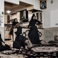 Women gathered at home after the commemorations for the Imam Hossein. Nooshabad, Iran, November 2012.