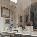 "Rambod's graphic design studio. Rambod studied and worked in gragphic design field in Tehran. He graduated in Fine Arts in Chicago but he could never find a good job. ""If as an Iranian artist I had focused my work on criticism of Iran, I probably would have had space in the art market"". Now he runs a graphics studio with a friend of his. Their work has increased after the sanctions because the new Iranian startups are replacing the foreign companies that have left, and they need a brand. Tehran, Iran. February 2019."