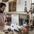 Rahi in his house, making a coffee. Tehran, Iran. February 2019.