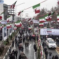 Iran, 40 years of revolution. Iranians march to Azadi (Freedom) Square during the ceremony celebrating the 40th anniversary of the Islamic revolution in the capital Tehran. On the road the flags of Israel and the United States to be trampled in contempt. Tehran, Iran. February 11th 2019.